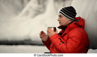 The guy is drinking tea on ice. - The tourist guy decided to...
