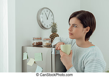 Woman having a coffee break at home - Young woman having a...