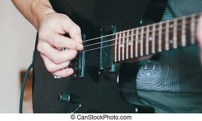Guitarist Playing An Electric Guitar At Home Studio -...