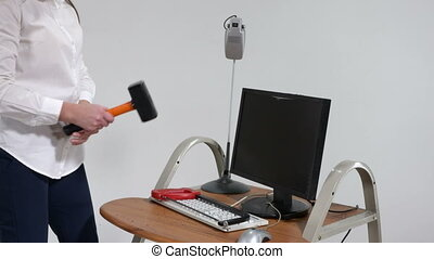 Stressed office worker smashing desktop computer with...