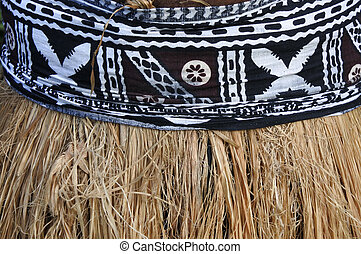 Background of traditional Pacific Island straw skirt and...