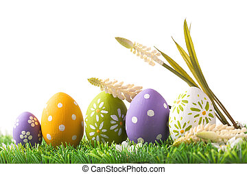 Bunch of easter eggs in pastel colors on grass, isolated on...