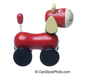 Wooden Rolling Cow Toy Isolated