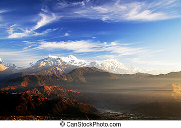 Mounts Annapurna II, IV and Lamjung Himal at Dawn, Nepal -...
