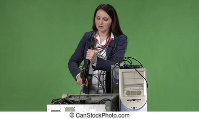 Frustrated woman office worker having problem with computer trying to repair