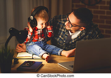 family father and son baby listening to music with headphones