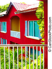 the balcony view on traditional caribbean house in lush foliage