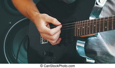 Guitarist Playing An Electric Guitar At Home Studio. Black...