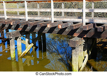 Wooden trestle footbridge - Old railway trestle reclaimed as...