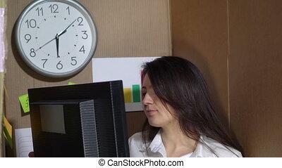 Office worker working on desktop computer in a cardboard box...