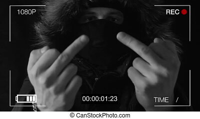 the masked robber shows on a hidden camera the finger - the...