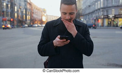 Man with cellphone in the city at day