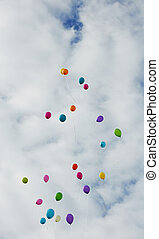 Color ballons flying up in to the sky