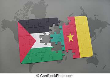 puzzle with the national flag of palestine and cameroon on a...