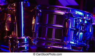 Drum set in the stage in soundlights ready to be played on...