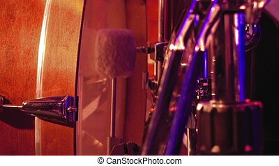 Drummer plays on a bass drum with pedal - Drummer plays on a...