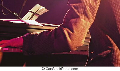 Piano player on the stage - Piano player plays the piano...
