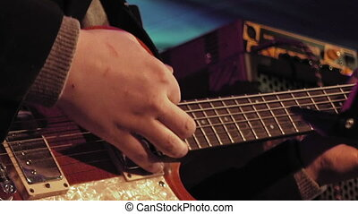 Guitar player on the stage - Guitar player plays the...