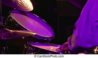 Drummer plays on drum set and cymbal with drumsticks on the...