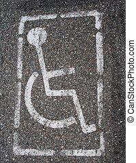 Handicap sign painted on pavement - a handicap parking sign...