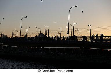 Galata Bridge in Istanbul, Turkey - Silhouette of Galata...