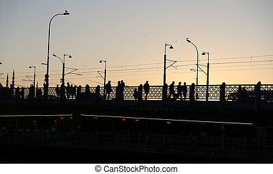Galata Bridge in Istanbul, Turkey - Silhouette of Galata...
