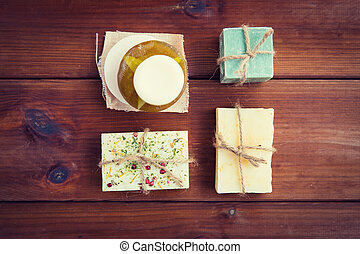 close up of handmade soap bars on wood - beauty, spa, body...