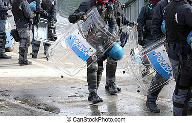 police with shields and riot gear during the sporting event...