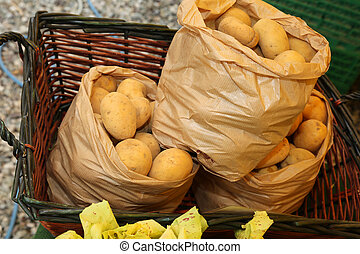 three bags of organic potatoes for sale in market fruit