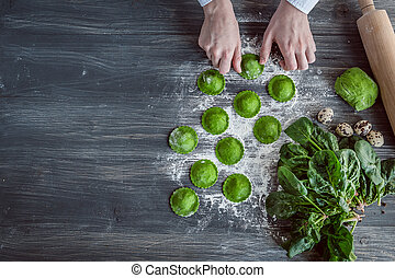 chef step by step, preparing a green ravioli with the...
