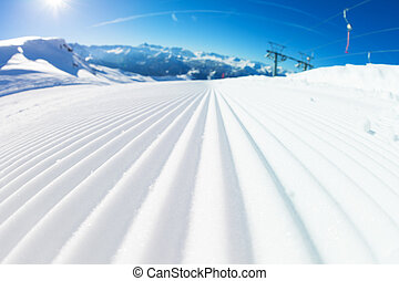 Fresh tracks of snowcat at snowcapped slopes