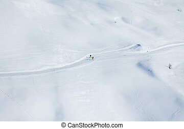 Two skiers running on the snowcapped mountains - Top view...