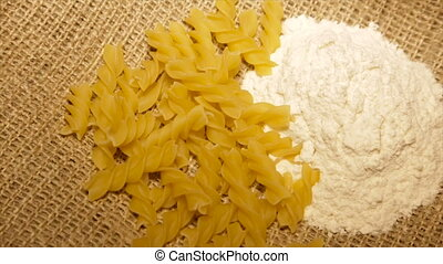 Serve pasta sprinkled with flour, with rotation.slow motion