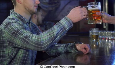 Man drinks beer at the pub - Young caucasian man drinking...