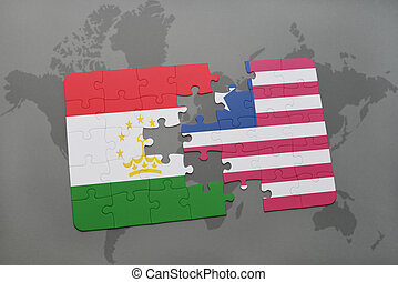 puzzle with the national flag of tajikistan and liberia on a...