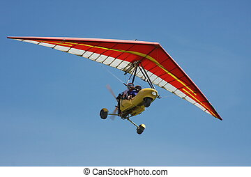hang-glider on a background blue sky