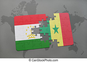 puzzle with the national flag of tajikistan and senegal on a...