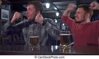 Friends celebrate success of their team at the pub