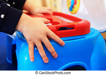 Child's hands on blue toy box - Child's hands on colorful...