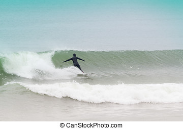 New Jersey Surfers - Surfers battle the cold waters of the...