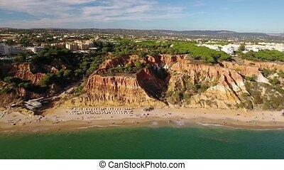 Aerial. Flight along coast and beaches Olhos de Agua. Albufeira