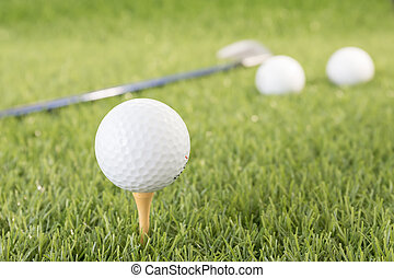 Golf ball on tee - Golf ball sitting on tee putting in golf...