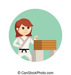 karate woman doing breaking boards technique in circle background