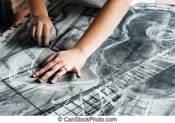 Young artist painting with charcoal