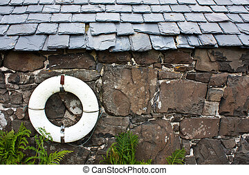 Life-preserver on a wall in a fishermen village - Scotland