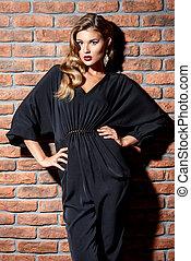 black overalls - Attractive female model posing in...