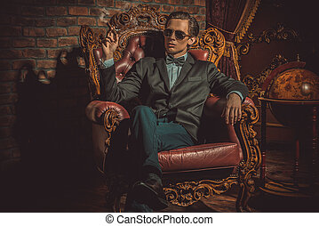 imposing handsome - Imposing well dressed man in a classic...
