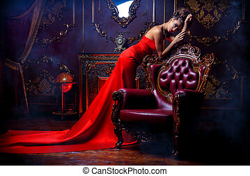 lady in a castle - Magnificent young woman in luxurious red...