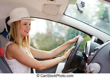Woman driving car with hand on horn button - Transportation...
