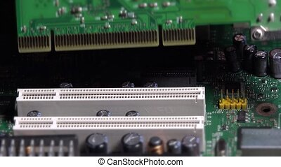 Hand insert pci card into motherboard slot on desktop...